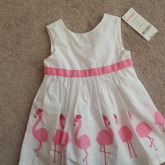 White dress with flamingos